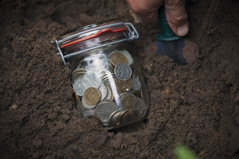 Jar of change in the dirt